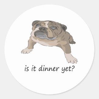 Perrito hambriento del dogo etiqueta redonda