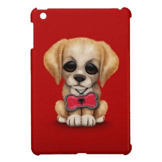 Perrito lindo con la etiqueta albanesa del mascota