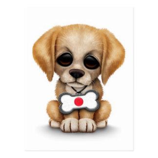 Perrito lindo con la placa de identificación japon tarjeta postal