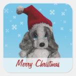 Perrito lindo del navidad en etiqueta del regalo