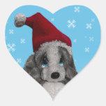 Perrito lindo del navidad en pegatinas del corazón pegatina de corazón