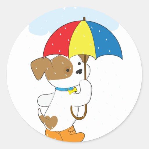 Perrito lindo en lluvia pegatinas redondas