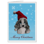 Perrito lindo en tarjeta de Navidad del gorra de S