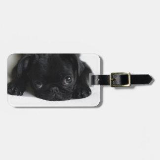 Perrito negro del barro amasado etiquetas de maletas