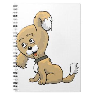 Perrito que escucha cuadernos
