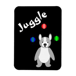 Perrito que hace juegos malabares imán rectangular