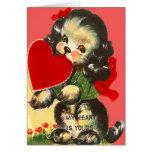 Perrito retro del vintage con la tarjeta de la tar