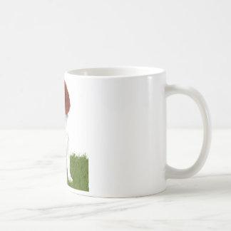 Perrito rojo y blanco irlandés del organismo taza de café