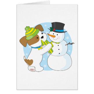 Perrito y muñeco de nieve lindos tarjeta de felicitación