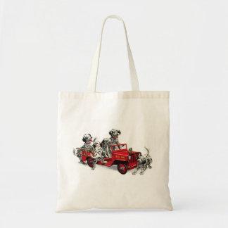Perritos dálmatas con el coche de bomberos bolsas de mano