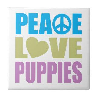 Perritos del amor de la paz teja