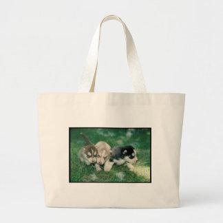 Perritos del husky siberiano bolsa