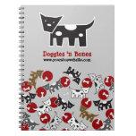 Perritos y cuaderno manchados dibujo animado lindo