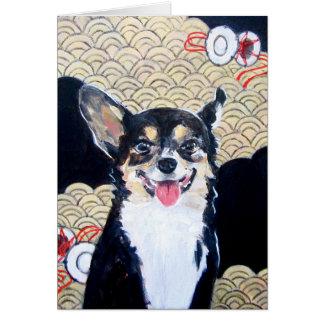 Perro con la tarjeta de felicitación del kimono