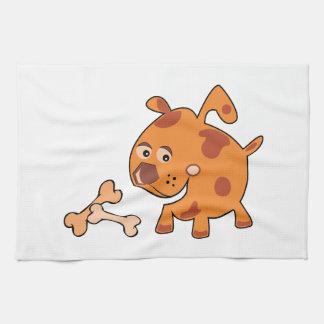 Perro con los huesos toallas