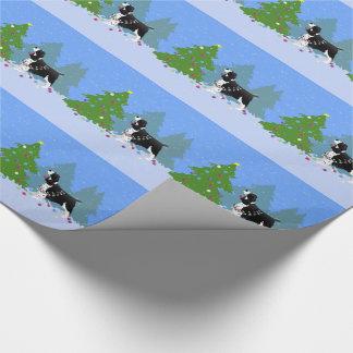 Perro de aguas de saltador negro que adorna el papel de regalo