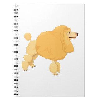 Perro de caniche amarillo libros de apuntes con espiral