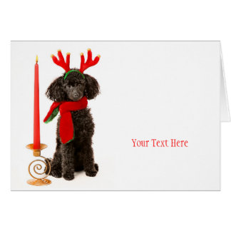 Perro de caniche de juguete del navidad tarjetón