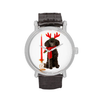 Perro de caniche negro de juguete del navidad vest relojes