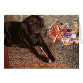 Perro de Halloween con la tarjeta del gusto por lo