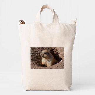 Perro de las praderas en agujero bolsa de lona duck