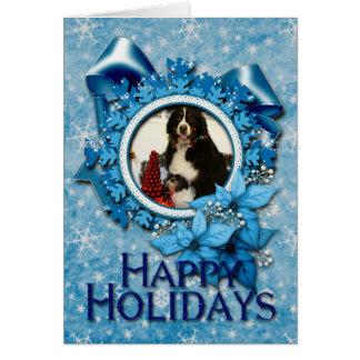 Perro de montaña de Bernese y foto del navidad de  Felicitación