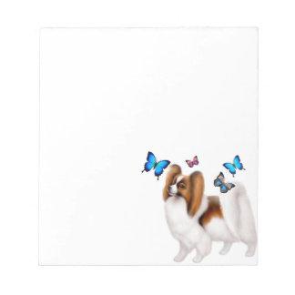 Perro de Papillon con la libreta de las mariposas Bloc De Notas