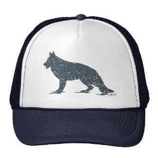 Perro de pastor alemán con el gorra azul de los co