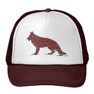 Perro de pastor alemán con el gorra rojo de los co
