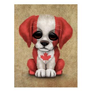 Perro de perrito canadiense patriótico lindo de la tarjeta postal