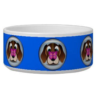 Perro de perrito del beagle y cuenco lindos del comedero para mascota