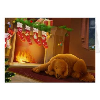 Perro de perrito dormido delante de la chimenea tarjeta de felicitación