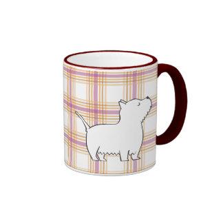 Perro de Terrier en la taza del fondo del tartán