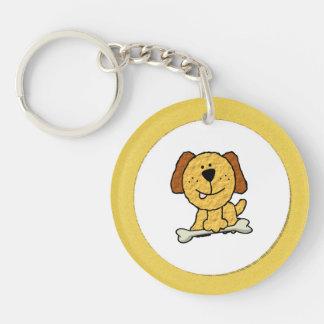Perro del dibujo animado con un hueso en amarillo llavero redondo acrílico a una cara