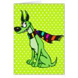 Perro del dibujo animado que lleva una bufanda felicitación