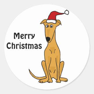 Perro divertido del galgo en arte del navidad del pegatina redonda