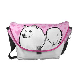 Perro esquimal americano/amor alemán del perro de bolsas de mensajería