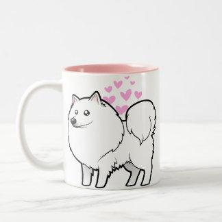 Perro esquimal americano/amor alemán del perro de taza dos tonos