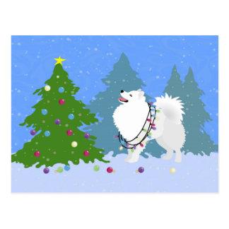 Perro esquimal americano que adorna el árbol de postal