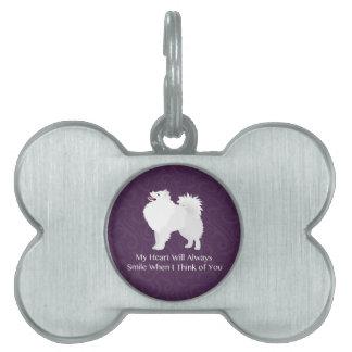 Perro esquimal americano que piensa en usted placa mascota