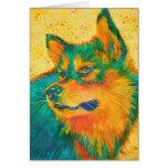 Perro esquimal colorido de la tarjeta de felicitac