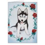 Perro esquimal con los rosas felicitacion
