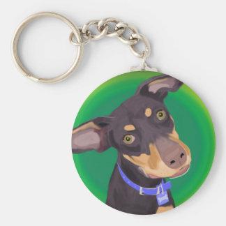 Perro lindo de la mezcla del Doberman en un fondo  Llavero Redondo Tipo Pin