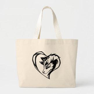 Perro/lobo en diseño tribal del corazón bolsa de tela grande