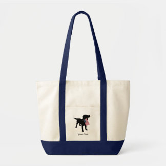 Perro negro del laboratorio con la bandera bolsa tela impulso