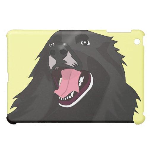 Perro negro lindo con su lengua hacia fuera -