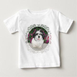 Perro negro y blanco del rescate del perrito de playera de bebé