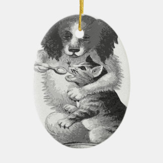 Perro que alimenta un gato adorno ovalado de cerámica
