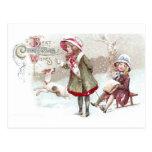 Perro y chica en navidad del vintage del trineo tarjeta postal
