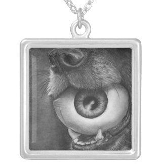 Perro y collar de la bola del ojo